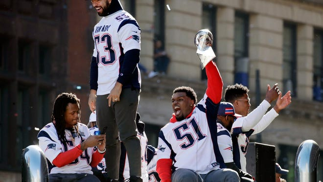 New England Patriots Dont'a Hightower (54), Kyle Van Noy (53) and Ja'Whaun Bentley (51) react to fans during a victory parade in downtown Boston, Tuesday, Feb. 5, 2019, to celebrate their win over the Los Angeles Rams in Sunday's NFL Super Bowl 53 football game in Atlanta. The Patriots have won six Super Bowl championships.