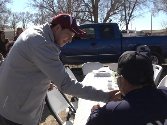 """A frame from """"The Mayors of Shiprock"""" shows then-Northern Diné Youth Committee member Adam J. Begaye meeting voters on election day in February 2015. Begaye was seeking a seat on the Central Consolidated School District Board of Education."""