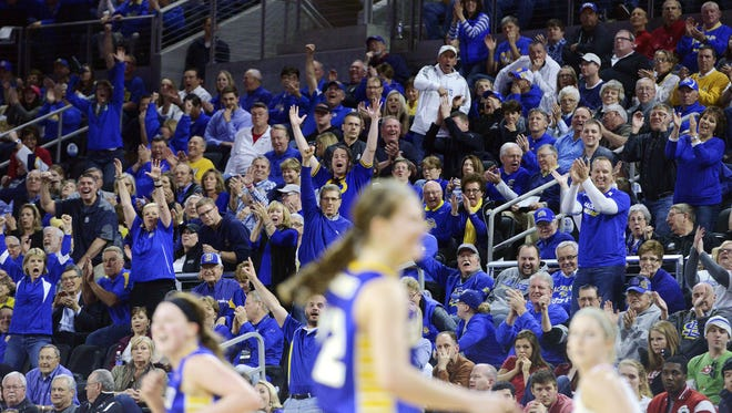 SDSU fans cheer after Ellie Thompson made a 3-pointer against USD in the 2015 Summit League women's basketball championship at the Denny Sanford Premier Center. The women's conference tournament was among the highest attended in the nation.