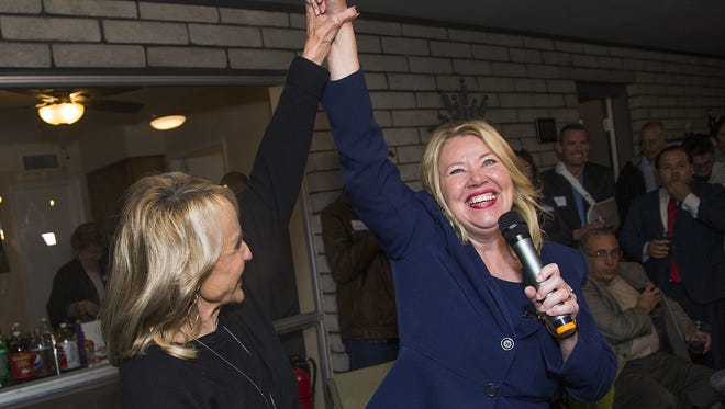 Former Gov. Jan Brewer, left, and Debbie Lesko, right, celebrate victory at a campaign gathering at home in Peoria on February 27, 2018. Lesko pulled out to an early lead in the special primary election.