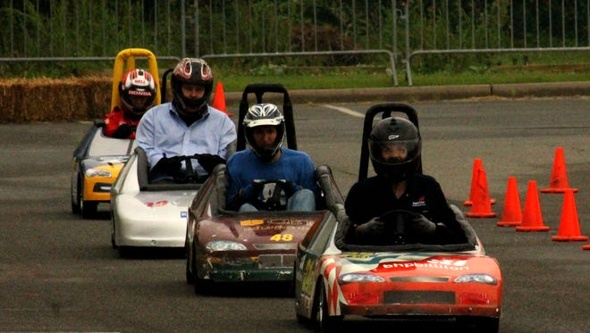 BPCC and Capitol one sponsor annual go-kart races to raise money for scholarship fund at BPCC in Bossier Saturday April 25,2015.