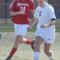 Opelousas Catholic girls' soccer player Kelly Soileau moves up field on the attack last Saturday in a game against the Academy of the Sacred Heart. Soileau and the 14th-seeded Vikings host a first-round Division IV playoff game Friday at Moore Park beginning at 5:30 p.m. against No. 19 St. Charles.