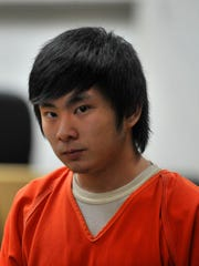 Dylan Yang, 15, of Wausau, is escorted to the courtroom Wednesday during his competency hearing at the Marathon County Courthouse in Wausau.