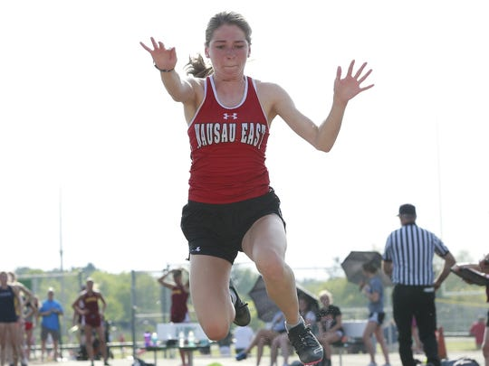 Wausau East's Quinn Lodholz competes in the girls triple jump during WIAA Division 1 sectional track and field competition on Thursdat at Stiehm Stadium.