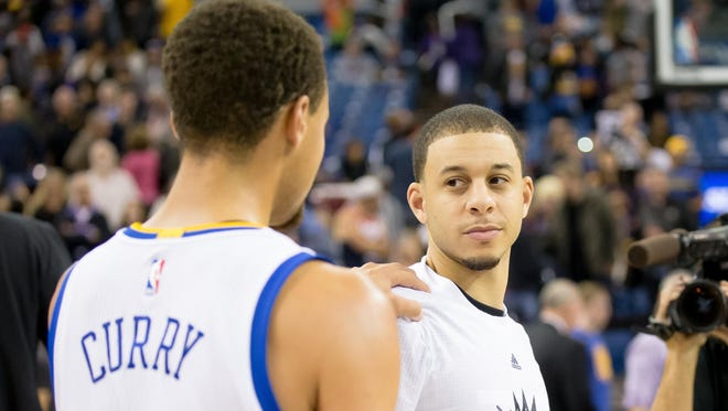 Stephen Curry and younger brother Seth Curry after a game at Sleep Train Arena.