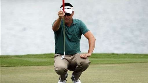 Robert Allenby putts during the second round of the Sony Open on Friday.