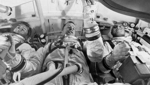 FILE - In this undated photo made available by NASA, from left, astronauts Roger Chaffee, Edward White II, and Virgil Grissom, practice for their launch test in the Apollo Mission Simulator at Cape Kennedy, Fla. During a launch pad test on Jan. 27, 1967, a flash fire erupted inside their capsule killing the three Apollo crew members.