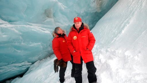 Russian President Vladimir Putin, foreground, and Defense Minister Sergei Shoigu, inspect a cavity in a glacier on the Arctic Franz Josef Land archipelago in Arctic Russia, Wednesday, March 29, 2017. Russia has sought to strengthen its foothold in the Arctic amid intensifying rivalry for the region's rich natural resources between polar countries.