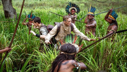 """Tom Holland, center left, and Charlie Hunnam, center right, in """"The Lost City of Z."""" The film opens Thursday at Regal West Manchester Stadium 13."""