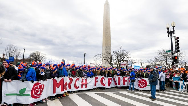 Protesters prepare to march during the 44th Right to Life March in Washington, D.C.