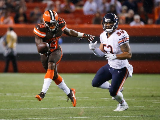 FILE - In this Sept. 1, 2016, file photo, Cleveland Browns wide receiver Corey Coleman (19) can't catch a pass against Chicago Bears inside linebacker John Timu (53) in the first half of an NFL preseason football game in Cleveland. Coleman broke his hand during practice Wednesday, Sept. 21, 2016, the latest major blow to a young, struggling team that has already lost two starting quarterbacks in the first two weeks of the season.  (AP Photo/Ron Schwane, File)
