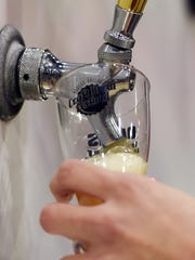 A beer is poured at the 2014 Hudson Valley Craft Brew Festival in the City of Poughkeepsie.