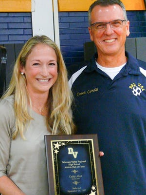 Doubly honored, Cathy Abel was inducted into the Hall of Fame as an individual and as a member of the 2002 state championship soccer team. She's pictured with coach Scott Cariddi, who recently retired.