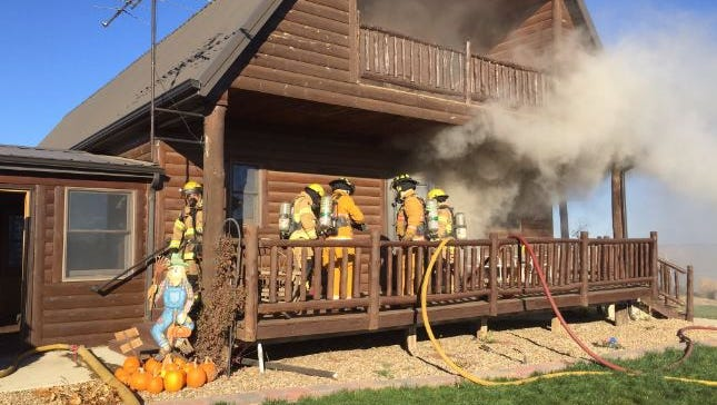 Firefighters battle a home fire south of Humboldt on Wednesday morning.