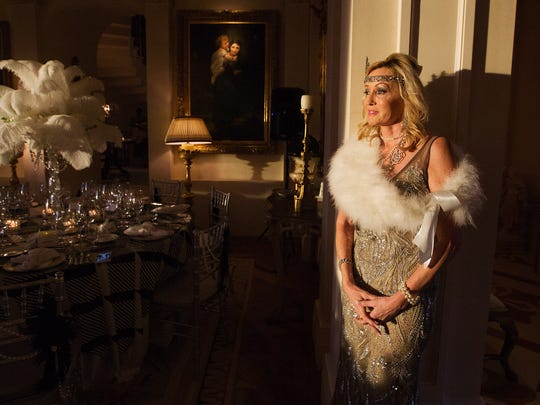 Cheryl Andrews attends a vintner dinner Friday at the  home of Lee and Penny Anderson in Naples. The dinner was held in support of the Naples Winter Wine Festival.