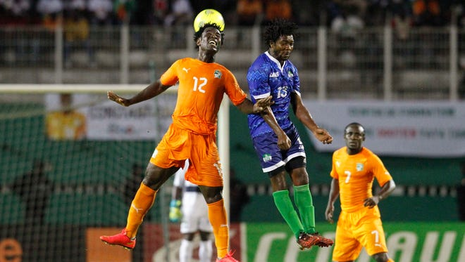 Sierra Leone's Michael Lahoud, right, fights for the ball with with Ivory Coast's Bony Wilfried during a match in September.
