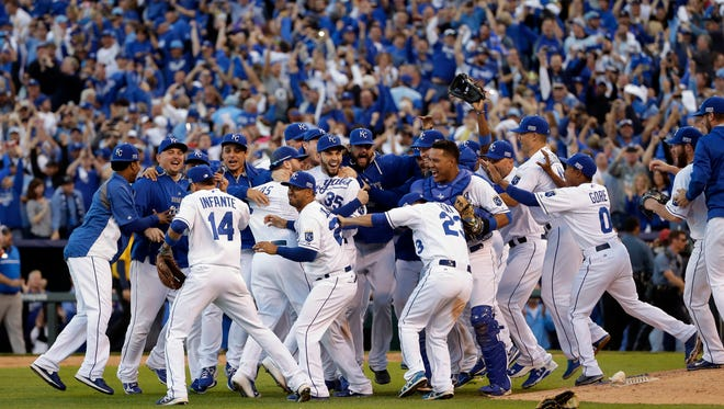 The Kansas City Royals players celebrate after the Royals defeated the Baltimore Orioles 2-1 in Game 4 of the American League baseball championship series Wednesday, Oct. 15, 2014, in Kansas City, Mo. The Royals advance to the World Series.  (AP Photo/Matt Slocum )
