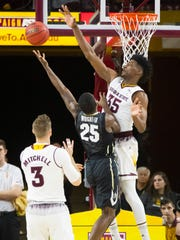 ASU's De'Quon Lake (35) blocks a shot from Colorado's