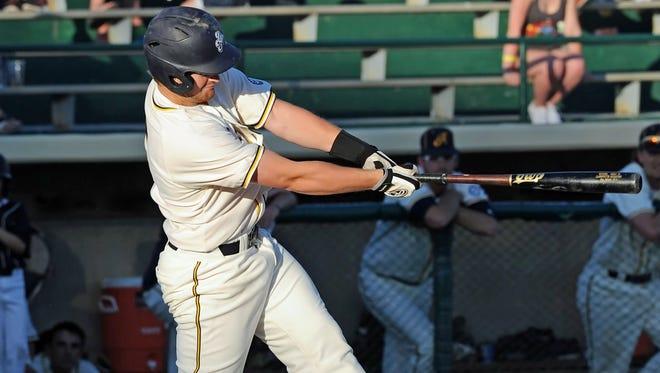Remington native Riley Benner levels the bat into the ball Wednesday night at Loeb Stadium.