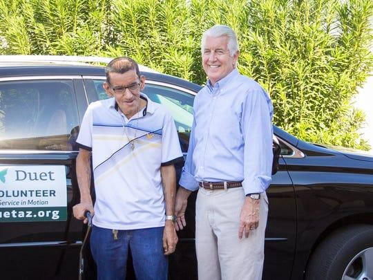 Jon Allen, a volunteer with Duet, helps give rides