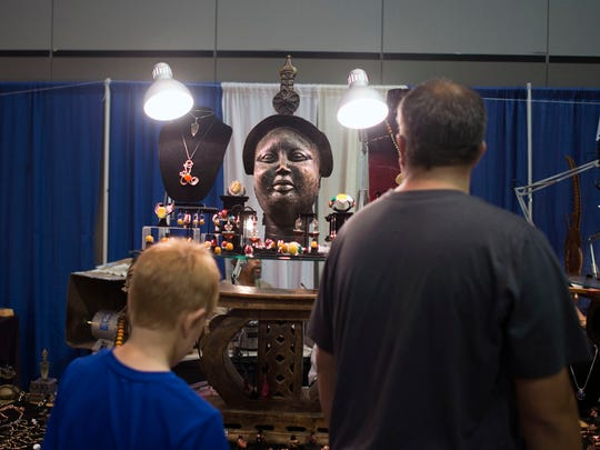 Timbuktu Art Colony displays handmade African artifacts at the Greek Festival on Saturday. Vendor and silversmith Henry Colby made his first trip to the Greek Festival on Saturday. during the 25th annual Greek Festival in Ocean City.