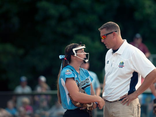 Delaware's Regan Green meets with manager Brad Lee after throwing an illegal pitch late in a game versus Latin America in the Big League World Series at Pyle Center in Millsboro.