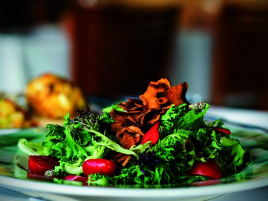 The Parkway House combines mixed field greens with slivers of bell pepper, cherry tomatoes, crispy sunchokes and peppered pistachios. The salad is topped with a sweet maple-walnut vinaigrette.