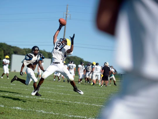 Senior Kani Kane attempts a one-handed grab as Sussex Tech varsity practices in Georgetown.