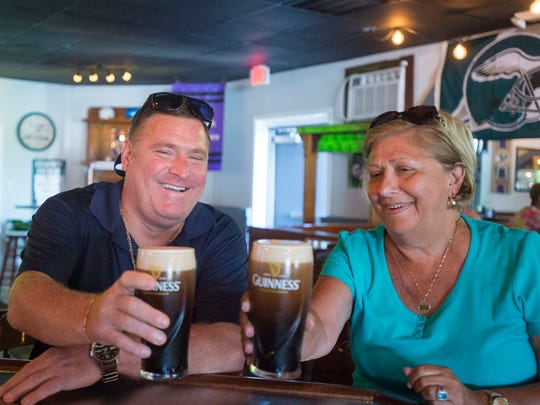 Owners Michael and Vivian Clarke share a drink at Claddagh on the Shore in Fenwick Island.