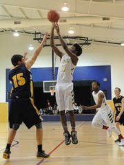 DePaul Cristo Rey junior Ky'Trell Simpson takes a shot in a 2016 game.