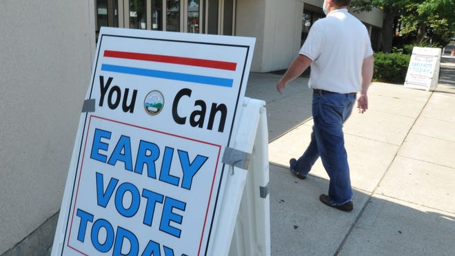 A Quincy vote walks into North Quincy High School during the State Primary Early Voting, Saturday, Aug. 22, 2020. Tom Gorman/For The Patriot Ledger