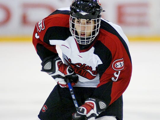Garrett Roe skates for the Huskies during a game in
