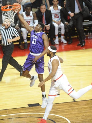 ACU's Jalone Friday scores his team's first basket four minutes into the game to make it 9-2 as a Texas Tech defender looks on. The No. 21 Red Raiders beat ACU 74-47 in the nonconference game Friday, Dec. 22, 2017 in Lubbock.