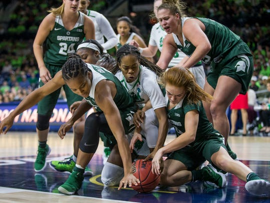 Michigan State's Shay Colley, left, and Taryn McCutcheon, right, compete with Notre Dame's Lili Thompson, center, for a loose ball during the second half of an NCAA college basketball game Wednesday, Dec. 6, 2017, in South Bend, Ind. Notre Dame won 90-59. (AP Photo/Robert Franklin)