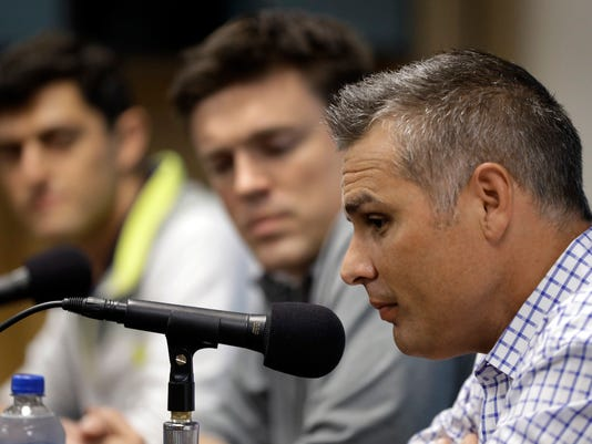 Tampa Bay Rays manager Kevin Cash, right, speaks to the media as senior vice-presidents of baseball operations Chaim Bloom, left, and Erik Neander, center, look on during a season ending baseball news conference Monday, Oct. 2, 2017, in St. Petersburg, Fla. The Rays finished their season on Sunday, ending with an 80-82 record. (AP Photo/Chris O'Meara)