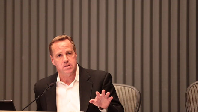 """Palm Springs Mayor Steve Pougnet on the dais Wednesday night. Pougnet told those in attendance, """"I am not going to resign tonight."""""""