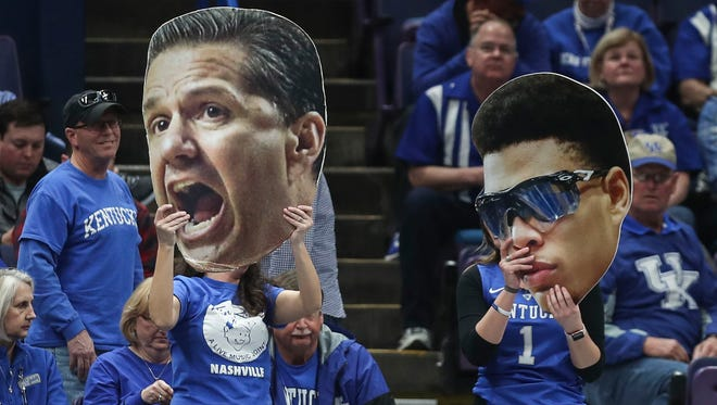 Two UK fans held up the cardboard heads of John Calipari and Quade Green during the Wildcats win over Georgia Friday afternoon.
