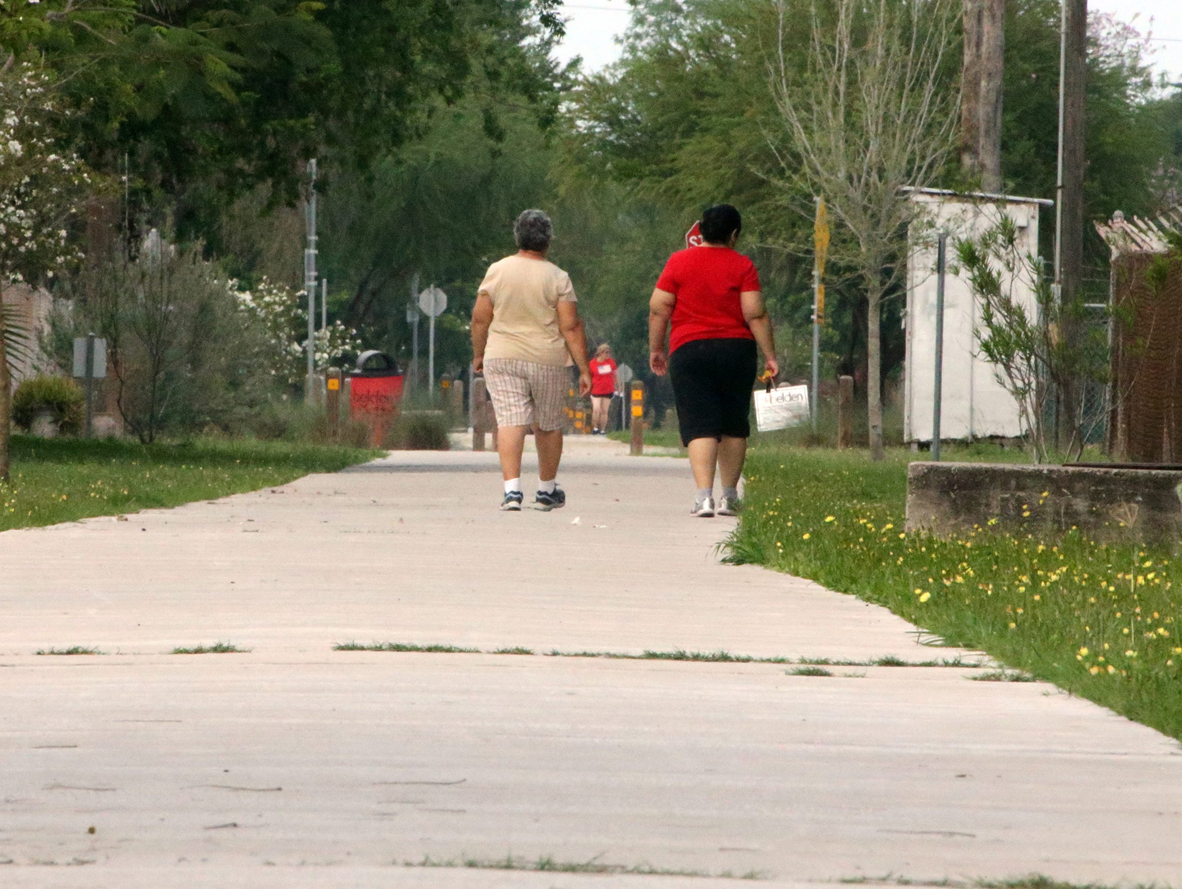 Brownsville residents go on a late afternoon walk along