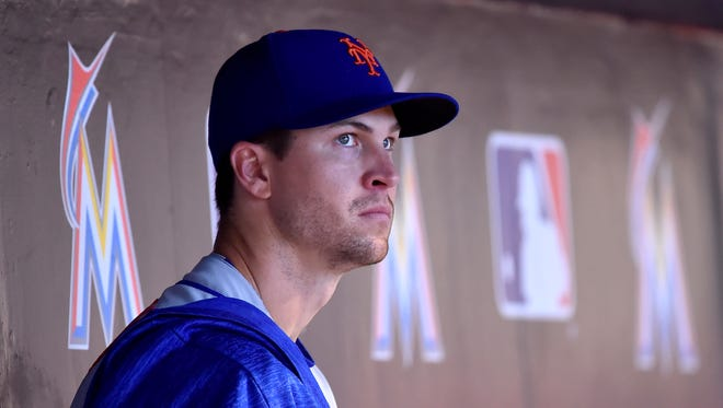 New York Mets starting pitcher Jacob deGrom (48) looks on from the dugout in the third inning against the Miami Marlins at Marlins Park.