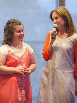 St. George resident Amber Graves, left, and her mom Michelle Graves address the crowd of friends and family during her 16th birthday celebration at the Falls Event Center Saturday, June 4, 2016.