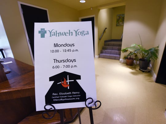 A sign directs participants to Yahweh Yoga classes