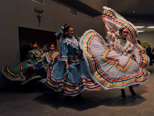 Members of St. Vincent Palotti's Ballet de Folklorico dance group perform Wednesday Sept. 26, 2017, at Holy Family Catholic Church after a prayer service.