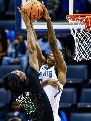 Memphis forward Kyvon Davenport (right) blocks the shot of Tulane guard Melvin Frazier (left) during first half action at the FedExForum in Memphis Tenn., Tuesday, January 9, 2017.