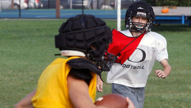 Delphi freshman Riley Lowder chases down a ball carrier as a scout team safety at Tuesday's practice.