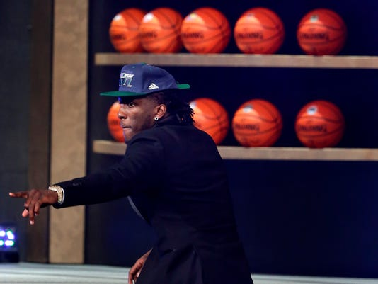 Taurean Prince reacts as he walks up on stage after being selected 12th overall by the Utah Jazz during the NBA basketball draft, Thursday, June 23, 2016, in New York. (AP Photo/Frank Franklin II)