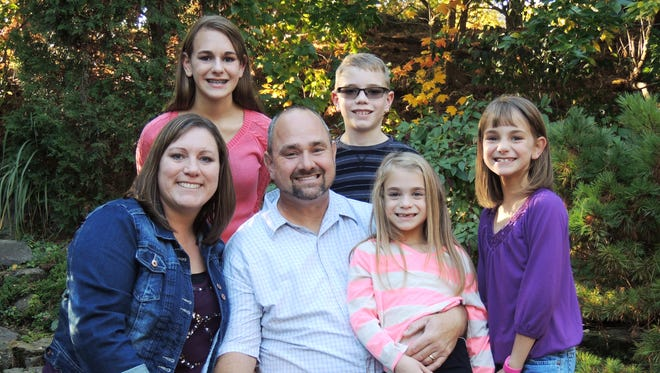 The late Daniel Witherow and his family. Sara, his wife, is at left, along with Nichole, Matthew, Kortney and Addison on his lap. Witherow was killed by a drunk driver in May.