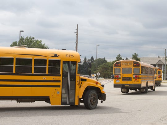 Buses loaded with Highlander Way Middle School students
