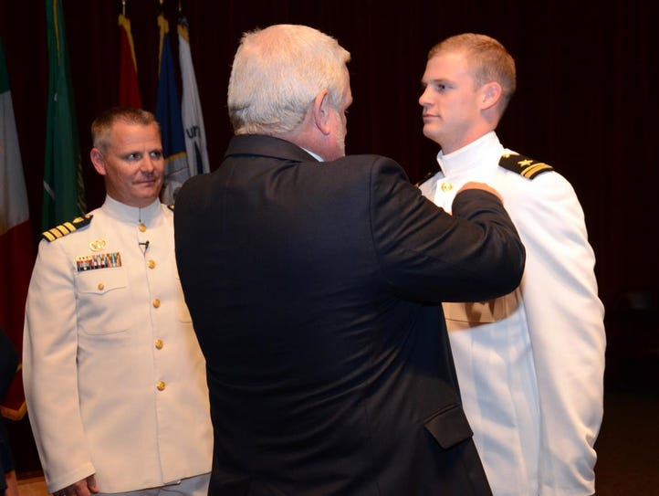 Lt. j.g. Payden Roberts, right, is pinned with his