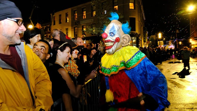 In this file photo, scary clowns interact with the crowd in Market Square for the annual Portsmouth Halloween Parade, October 31, 2019. Sadly, the popular parade will not take place in 2020 due to the coronavirus pandemic.