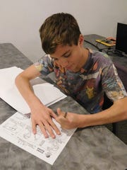 Using pencil and paper, campers create storyboards